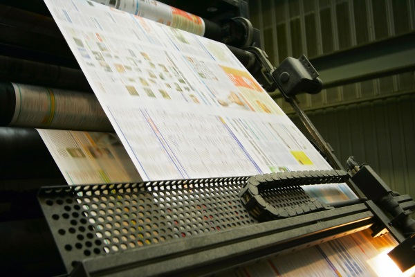 Photo of an newspaper being printed